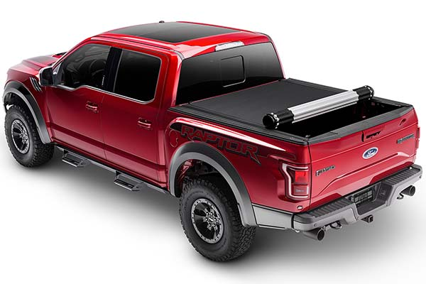 bak x4 revolver truck bed cover on red ford raptor