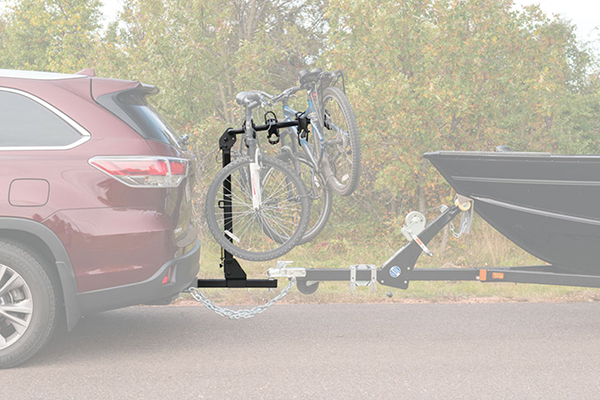 curt towable hitch mount bike rack installed with boat profile