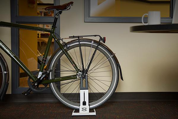 saris the boss bike floor storage rack in office