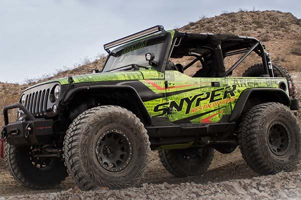 Green Jeep Wrangler with rock slider steps