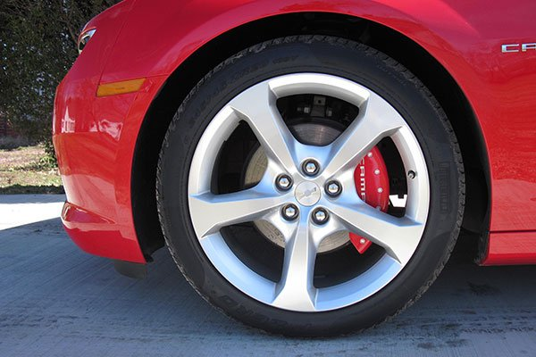 red mgp caliper cover installed on a chevy camaro