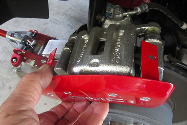 red mgp caliper cover installed on gmc terrain