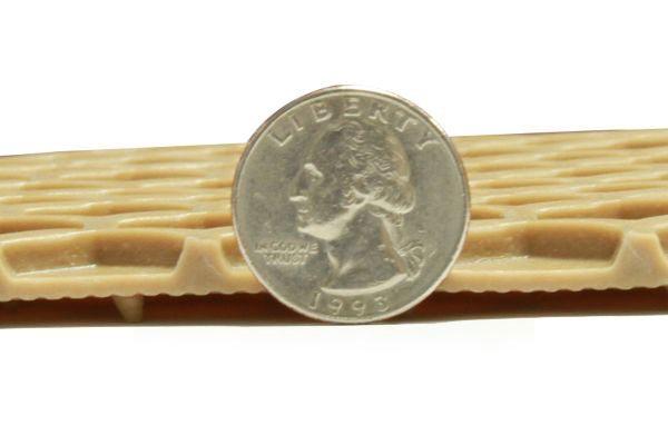 hexomat floor mat depth shown relative to a quarter