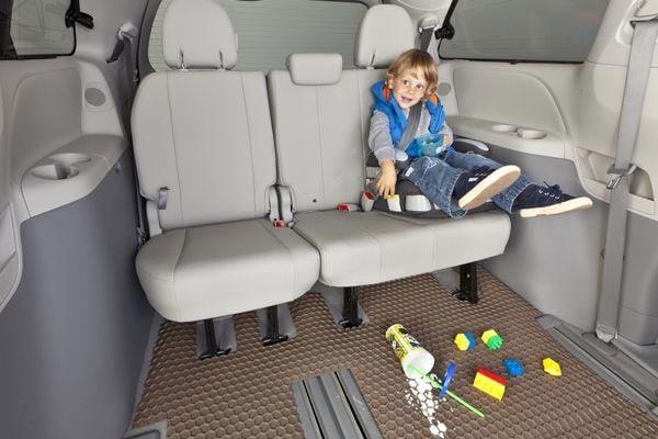 tan hexomats shown protecting vehicle floor below child