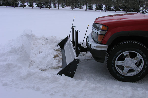 snow port snow plow red chevy pushing snowplow
