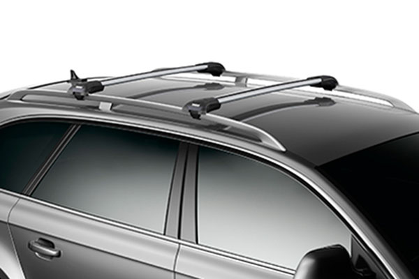 thule aeroblade roof rack system installed on raised factory roof rails