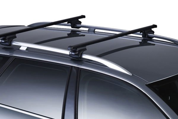 thule square bar base rack installed on raised bar