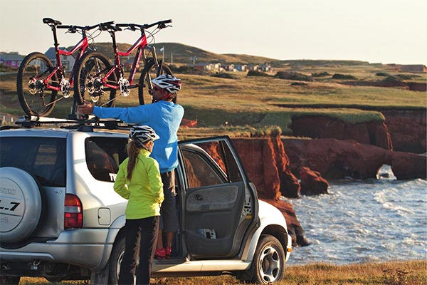 thule roof rack system loaded with bikes
