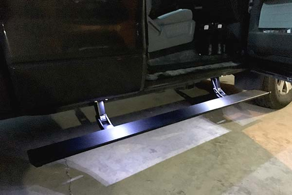 amp power steps shown on black crew cab truck