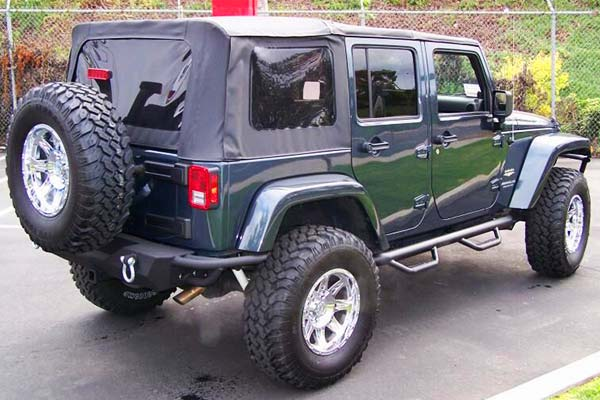 nfab nerf steps shown on 4dr jeep wrangler