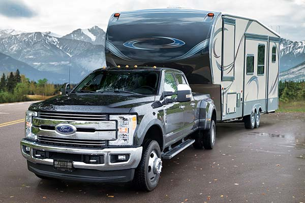 ford truck pulling camper equipped with loadlifter 7500xl