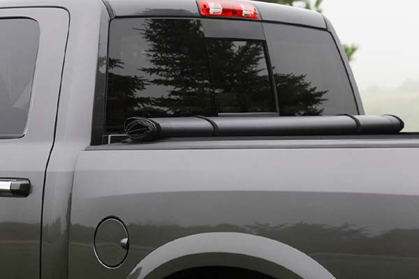Durable webbing straps secure cover behind cab