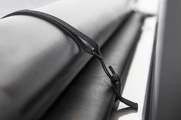 Straps secure the cover when it's rolled up