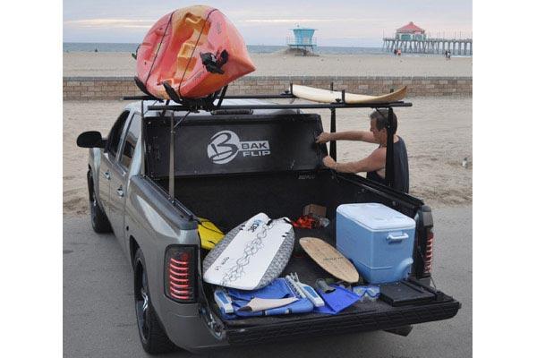 bak bakflip cs f1 tonneau cover with bakbox 2 toolbox beach lifestyle loaded