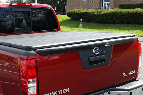 extang solid fold 2 tonneau installed on 2015 nissan frontier