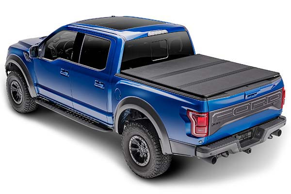 extang solid fold 2 truck bed cover installed on ford raptor