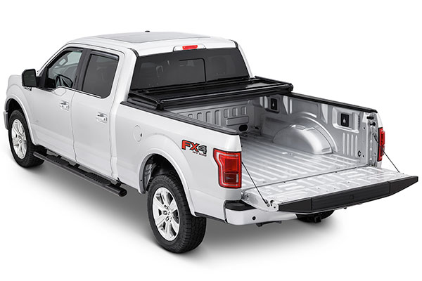 tonnopro hard fold tri fold tonneau cover opened installed on f150