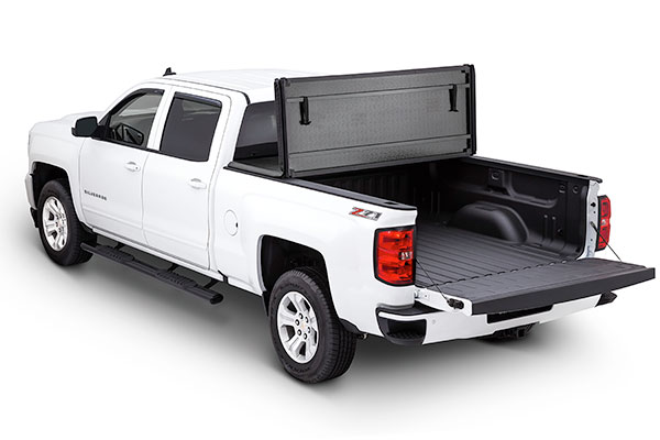 tonno pro hard fold installed on chevy silverado pictured open