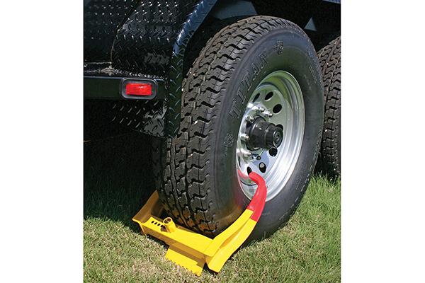 curt wheel chock lock installed grass