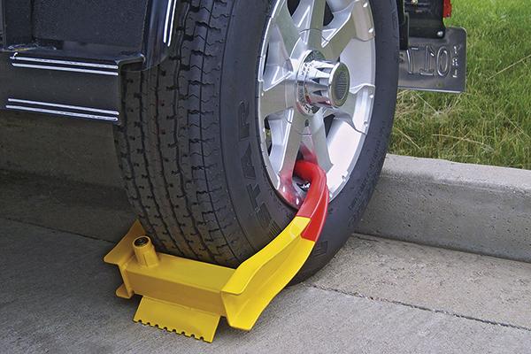 curt wheel chock lock installed pavement