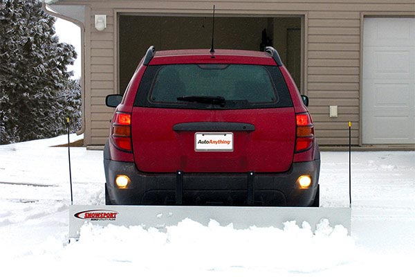 snowsport 180 utility snow plow backing out of garage